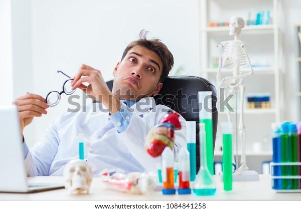 Funny doctor having fun in hospital lab