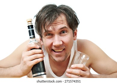 Funny and drunk man with a bottle of vodka and a glass closeup isolated