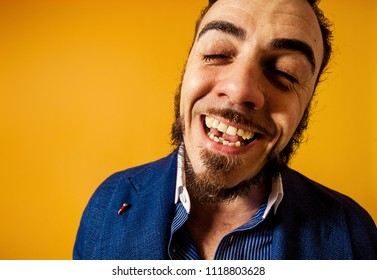 Funny and eccentric man portrait smiling with eyes closed