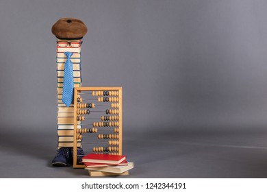 Funny education concept, smartest man teacher with abacus and books