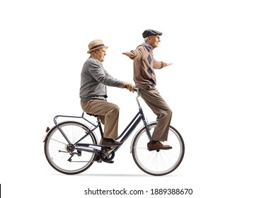 Funny elderly men riding a bicycle isolated on white background