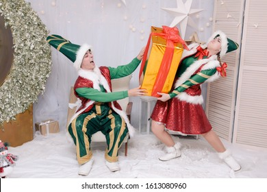 Funny elves packing gifts playing christmas xmas background poster