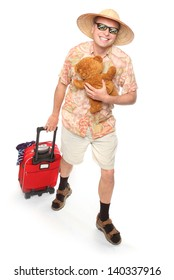 Funny european traveler with his suitcase and toys going to holidays.