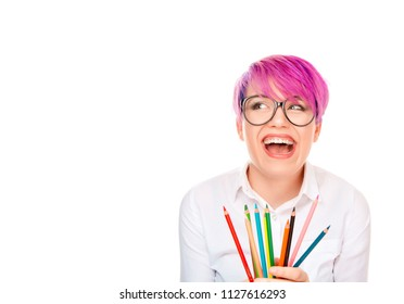 Funny excited young woman holding crayon pencils isolated white wall background. Free thinking new approach, Creativity, imagination, dynamism, intelligence concept. Crazy graphic designer concept.