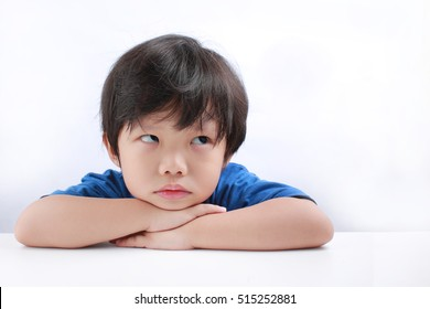 Funny expression of a little Asian boy isolated on white background