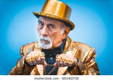 Funny and extravagant senior man posing on colored background - Youthful old man in the sixties having fun and partying