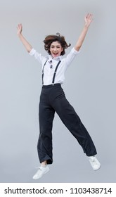 funny face from asian lady jumping on blank background. Happy people action with healthy face with good.
