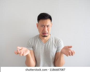 Funny face of Asian man denying something.