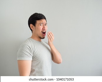 Funny face of bad breath Asian man.