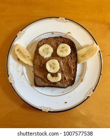 Funny face made with bananas on toast