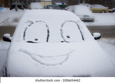 funny face on snow covered cars, winter fun