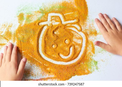 Funny face painted with colored sand