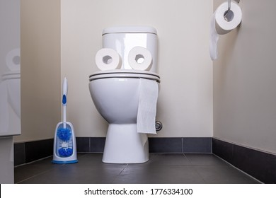 Funny face with tongue made from toilet paper and toilet bowl