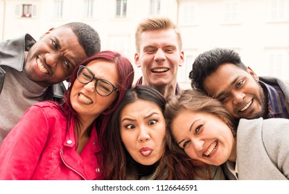 funny faces by friends, college students having fun together. young multi-ethnic people close up on faces with crazy expressions. concept of diversity  friendship carefree lifestyle and togetherness