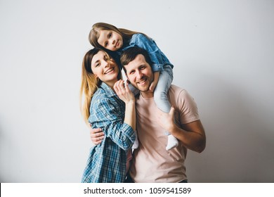 Funny family photo on grey background.