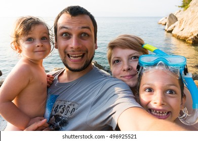 Funny family trip selfie shot with parents and children