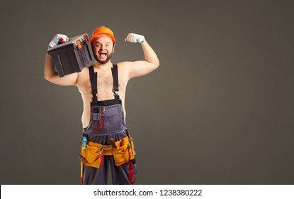 Funny fat bearded builder with a tool box.