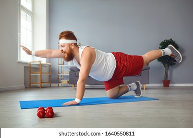 Funny fat man doing yoga exercises in the room.