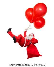 Funny flying Santa Claus falls with a bag full of x-mas gifts. Falling Santa holds air balloons isolated on white background. Santa Claus hover with balloon and carry sack with gift box.