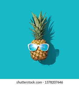 Funny fresh pineapple wearing sunglasses, summer fun concept