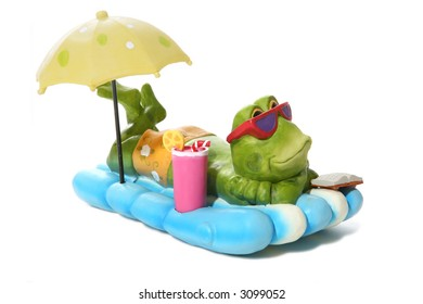 A funny frog relaxing under an umbrella while on vacation