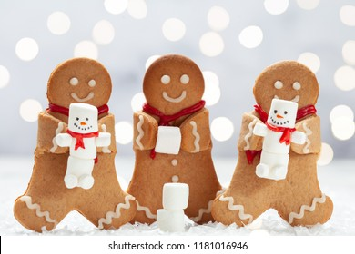 Funny Gingerbread cookie men with tiny marshmallow snowman