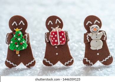 Funny Gingerbread cookie men with tiny marzipan snowman
