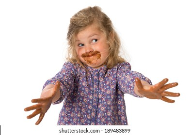 funny girl with chocolat on hands and mouth