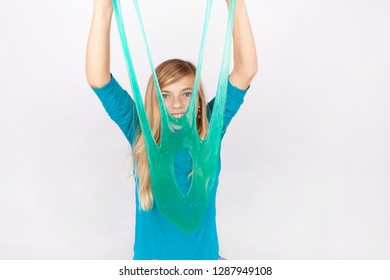 Funny girl holding a slime in front of her