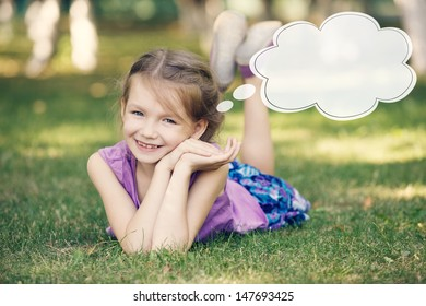 Funny girl laying on the grass and dreams about...