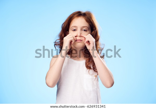 funny girl on blue background