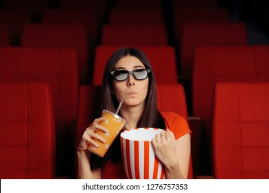 Funny Girl with Popcorn Watching 3D Movie in Cinema Theater. Film fan watching entertaining flick and snacking