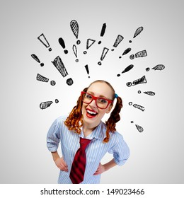 Funny girl in red glasses with exclamation signs