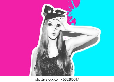 Funny girl represents small cat or mouse. Woman with bright makeup hairstyle and night dress mouse ears having fun. Colorful contrast background