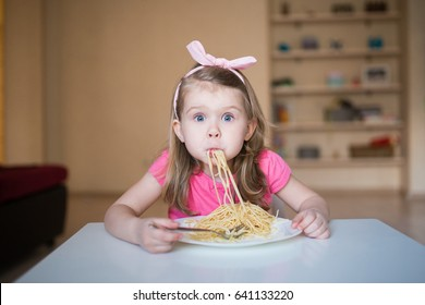 funny girl with spaghetti in her mouth
