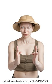 Funny girl in a tropical helmet holds palms ahead of itself on a white backgroung