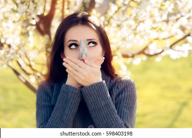 Funny Girl Trying Desperate Measures to Fight Spring Allergies - Cute spring woman protecting her nose from allergens