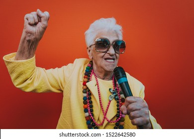 Funny grandmother portraits. Senior old woman dressing elegant for a special event. Rockstar granny on colored backgrounds