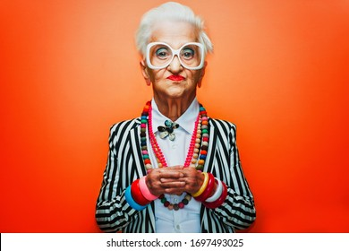 Funny grandmother portraits. Senior old woman dressing elegant for a special event. granny fashion model on colored backgrounds. Comic caricature drawing style