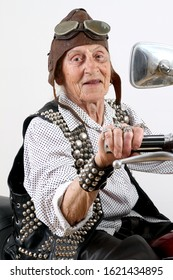 Funny granny ridding a bike Motorcycle rider old face grandmother Chopper motorcycle Old rider crazy face keep calm and carry on Easy living gangster style Old lady studio shoot isolated