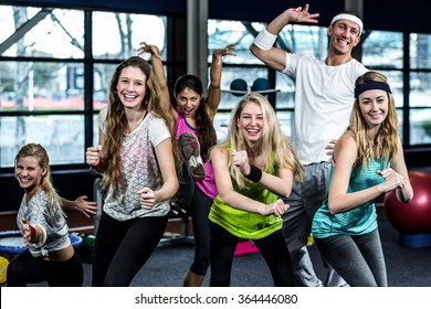 Funny group of dancer posing together in the gym