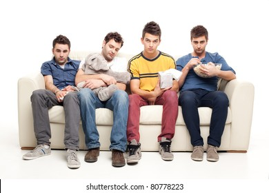 funny group of young men watching sad movie sitting on a couch