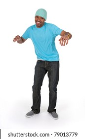 Funny guy in a blue t-shirt dancing, isolated on white background.