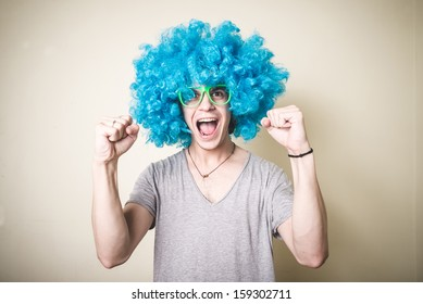 funny guy with blue wig singing on white background