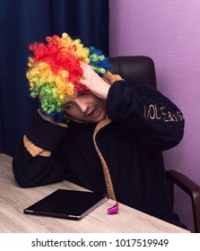 Funny guy with a colorful wig. Day of screaming.