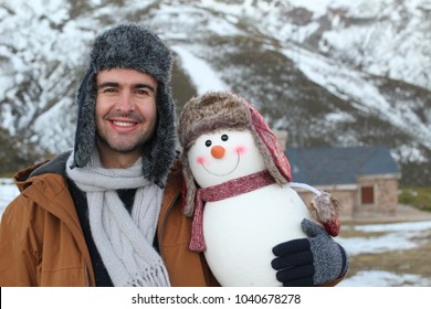 Funny guy with a cute snowman that looks like him