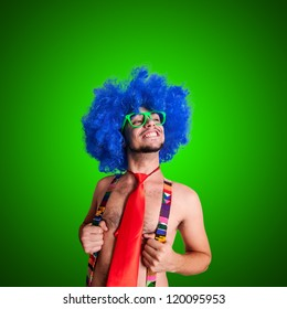 Funny guy naked with blue wig and red tie on grey backgrund