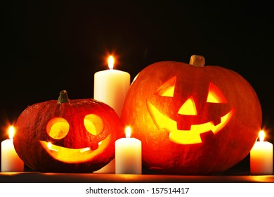 Funny Halloween pumpkins and burning candles