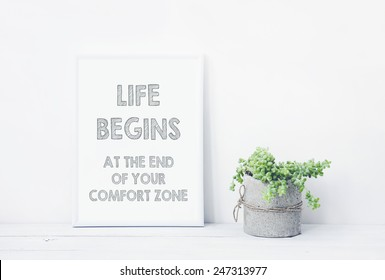 funny hand drawn poster LIFE BEGINS AT THE END OF YOUR COMFORT ZONE.  with succulent in diy concrete pot. Scandinavian style room interior