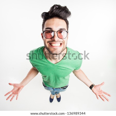 8358bd7ad45 funny handsome man with hipster glasses showing his palms and smiling large  - wide angle shot